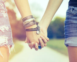 Best friends holding hands in the park